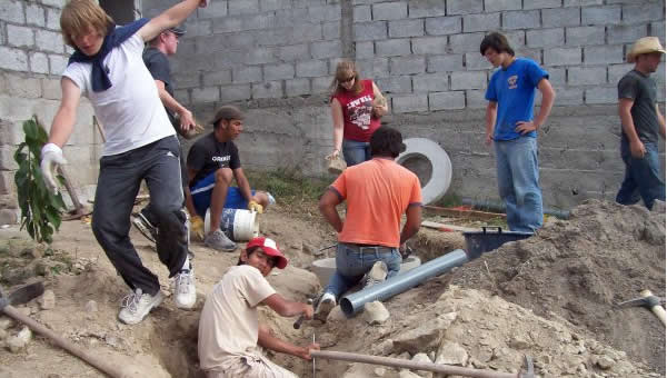 A youth group helps a family with their well.